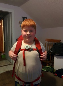 Wearing his new backpack, front view