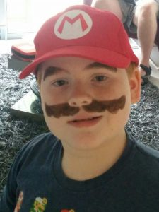 Kiddo made up as Mario